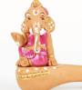 Aapno Rajasthan Pink & Brown Terracotta Ganesh Sitting on Sitar Showpiece