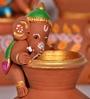 Exclusivelane Brown Terracotta Hand Painted Baby Ganesha Climbing on The Matki